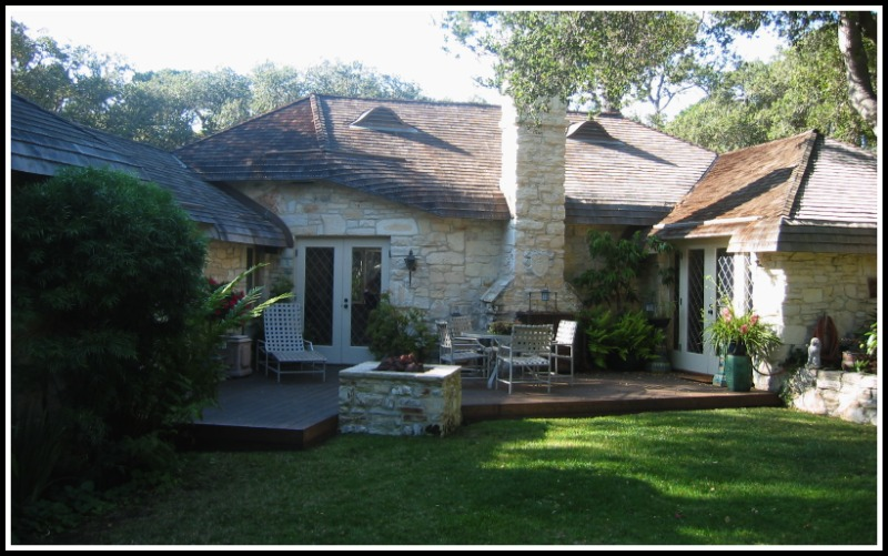 Stone House with rolled ceder shingle roofing