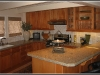 Gourmet kitchen with granite counters and tile back splash