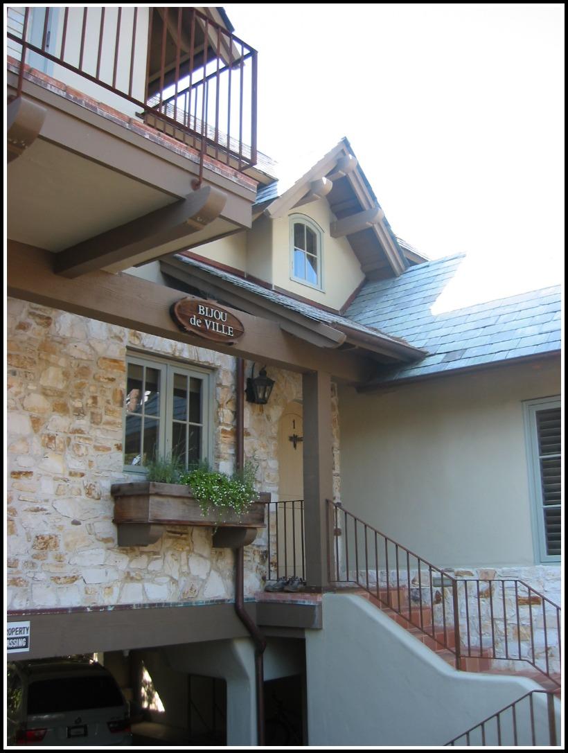 Street view of custom stone detailing, wood corbels, planters