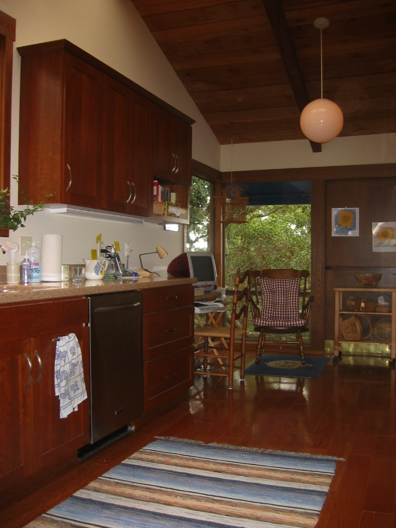 Cherry kitchen cabinets, composite counter tops, engineered wood flooring