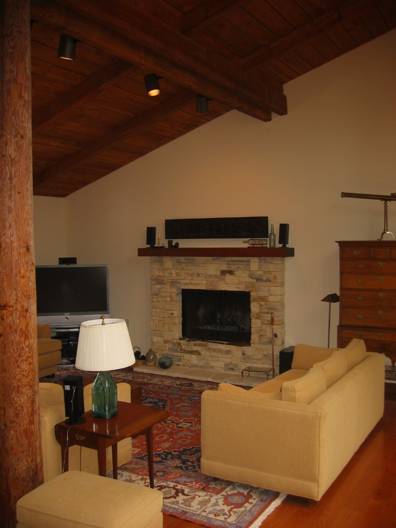 Carmel stone fireplace, custom wood mantle