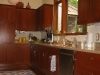 Cherry kitchen cabinets, composite counter tops, engineered wood flooring, new window