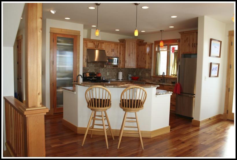 Granite counters, cherry floor, custom cabinets