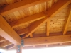 Exposed beam wrap around covered porch
