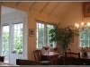 True divided windows, board and batten interior walls, vaulted ceilings