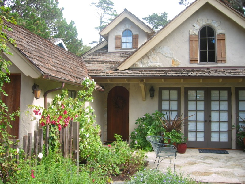 Charming Carmel cottage with stucco and stone accents